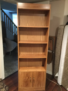 Bookcase 4 shelves, cupboard at bottom. In Parksville
