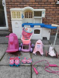 Girls outside toy bundle. Including kitchen,rocking horse, trolley