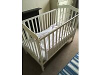 White cot with excellent mattress and changing table