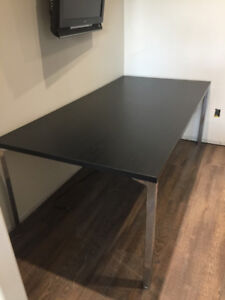 Black table with wood grain looking top