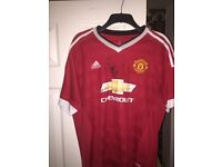 Signed Manchester United shirt by Phil Jones