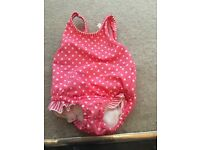 Baby swimming costume with integrated nappy