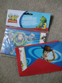 7 toy story party invitations, 1 pack of 6 and 1 spare