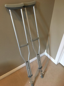 Crutches with ice spikes attached for winter