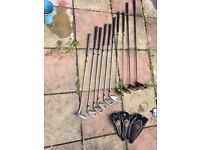 Set of John Daly golf clubs with bag.