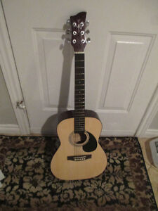 3/4 Acoustic guitar and gig bag