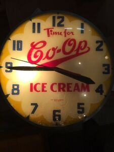 Early glass face Coop Ice Cream clock. Working