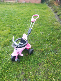Tricycle with parent steering handle
