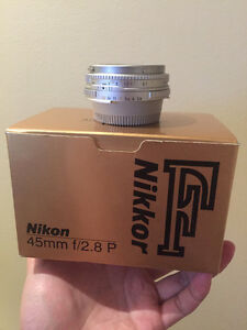 like new nikon AI S 45 2.8 P pancake lens in box