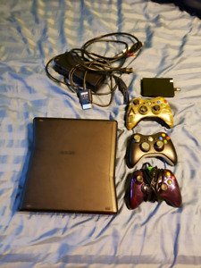 Xbox 360, 250 GB hard drive, 3 controllers and 3 games
