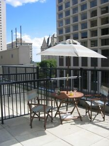 ENJOY SUN AND VIEW FROM YOUR SOUTH FACING PATIO ON JASPER AVENUE