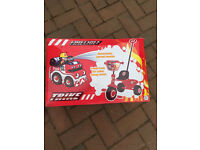 Fire engine themed kids trike with parent handle age 2+