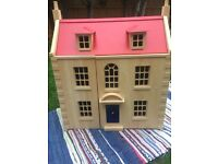 Solid wood doll house from john Lewis