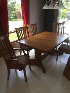 SOLID OAK DINING TABLE/ CHAIRS AND BUFFET