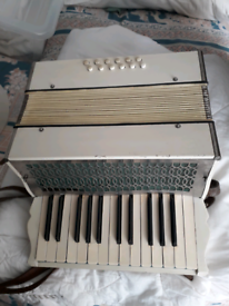 piano accordian with leather case