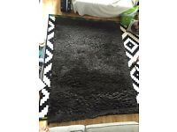 Dark brown IKEA rug