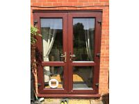 UPVC Rosewood French Doors with White interior and hole for Cat Flap