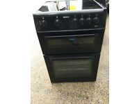 Beko 60cm black glass top electric cooker in mint. Condition with a warranty