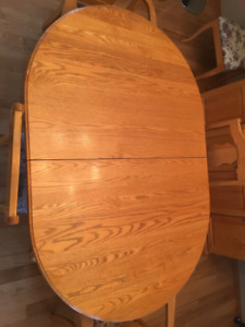 SOLID OAK DINING TABLE -6 CHAIRS--BUFFET AND LIGHTED HUTCH