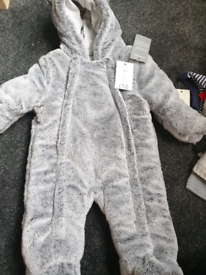 Brand new grey snowsuit. 0-3 months
