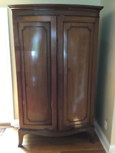 Walnut Armoire for sale.  Multi purpose.  Needs some fixing.
