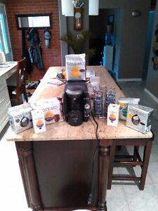 Tassimo coffee maker and 100 coffees
