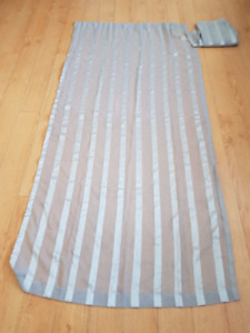 Two silver curtain panels