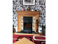 Traditional fireplace with electric fire