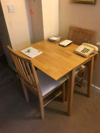 Table - fold away with 2 chairs