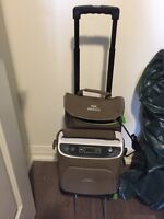 Philips Respironics portable oxygen concentrator and cart