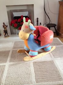 Rocking horse/ ride on moo cow with a restraint for younger children