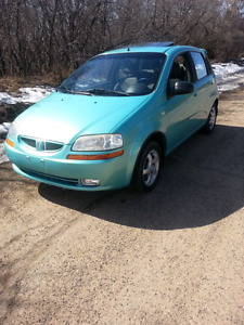AWESOME LITTLE PONTIAC WAVE LOADED WITH ONLY 95,700 KMS!