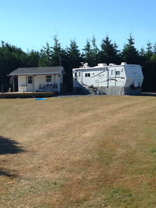 2 acres with trailer and cookhouse