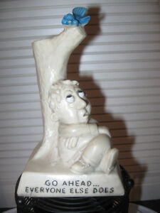 TYPICAL WOE-BEGONE STATUE that GETS the POINT ACROSS