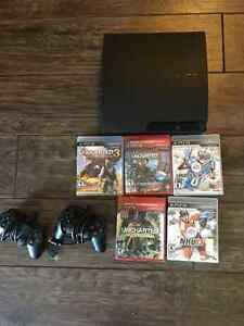 160 Gb playStation 3 with 5 games and 2 controllers for sale