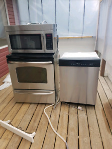 Stainless steel appliances and dog kennel