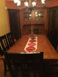 Solid oak dining room table and matching cabinet, seats 10