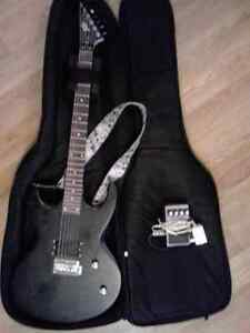 Black Peavey Guitar and Voyageur Case with Foot Pedal
