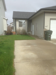 Spacious 3 bedroom 1/2 Duplex with Attached Garage