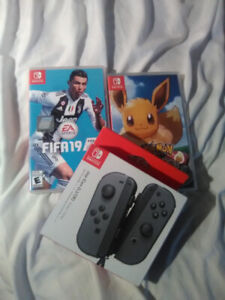 170 Joy con controller and Pokemon Eve and FIFA 19 new