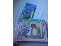 Doc McStuffins puzzle and peppa pig music set (both brand new)