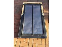 Velux roof window with flashings