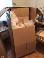 boites de déménagement et matériel d'empaquetage  À DONNER