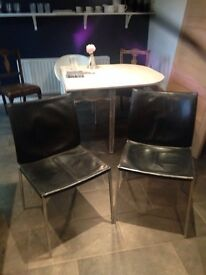 Two contemporary black leather chairs