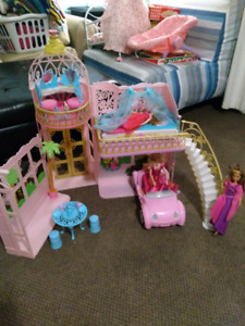 Barbie castle with lots of accessories and Barbies