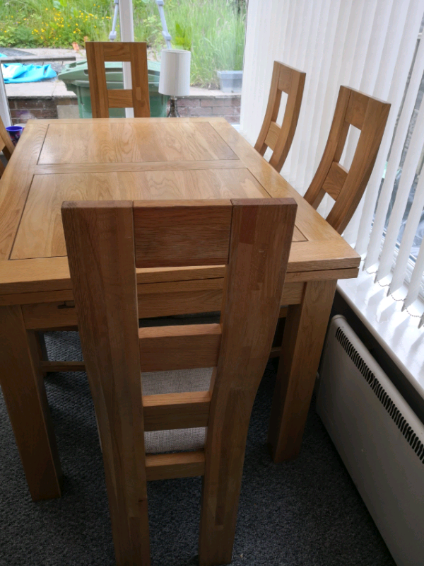Solid oak extending dining table and 6 chairs grey open to offers | in  Bolton, Manchester | Gumtree