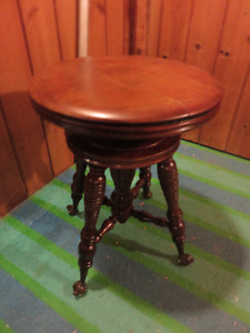 1 ANTIQUE SOLID WOOD PIANO STOOL WITH LION PAWS AND GLASS