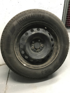 Four 15 inch tires on steel rims - 2 practically new