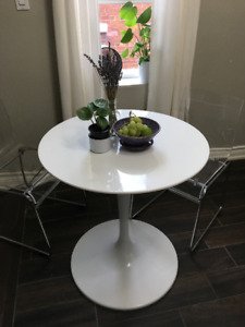White Dinette Table & Ghost Chair set.