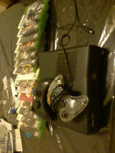 Xbox360 with 15 assorted games for sale